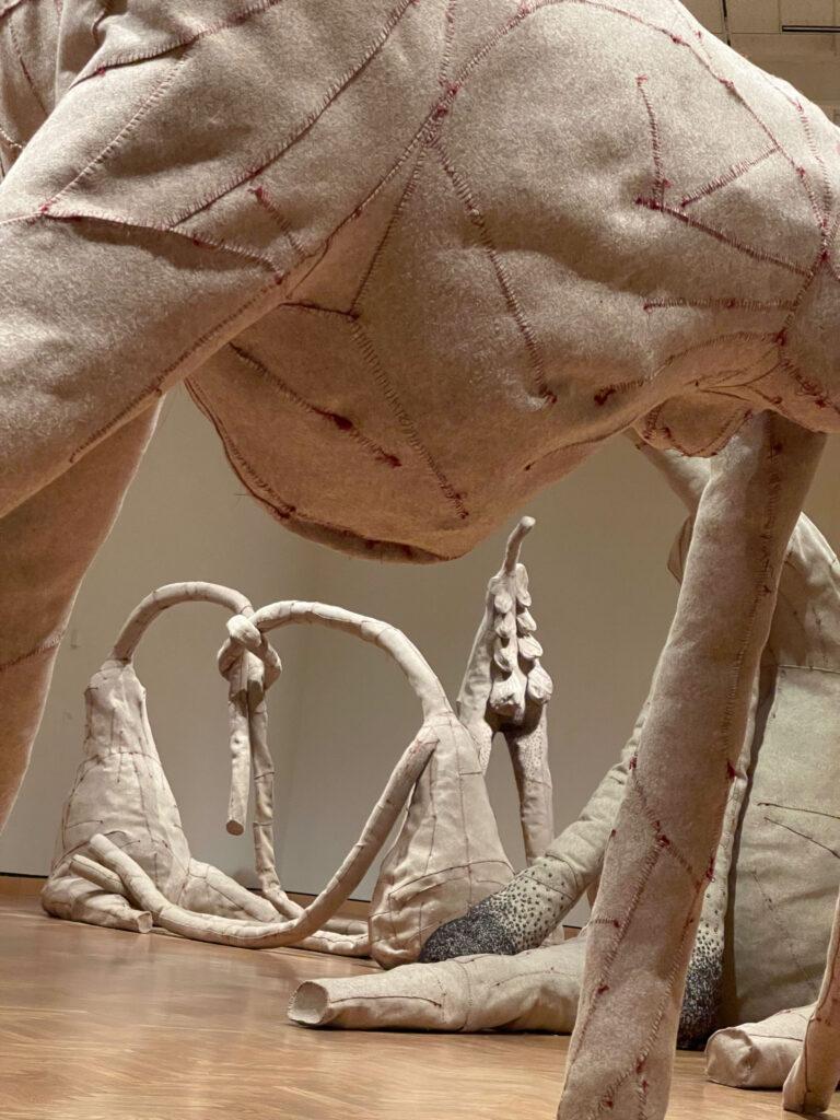Group of gray felt sculptures