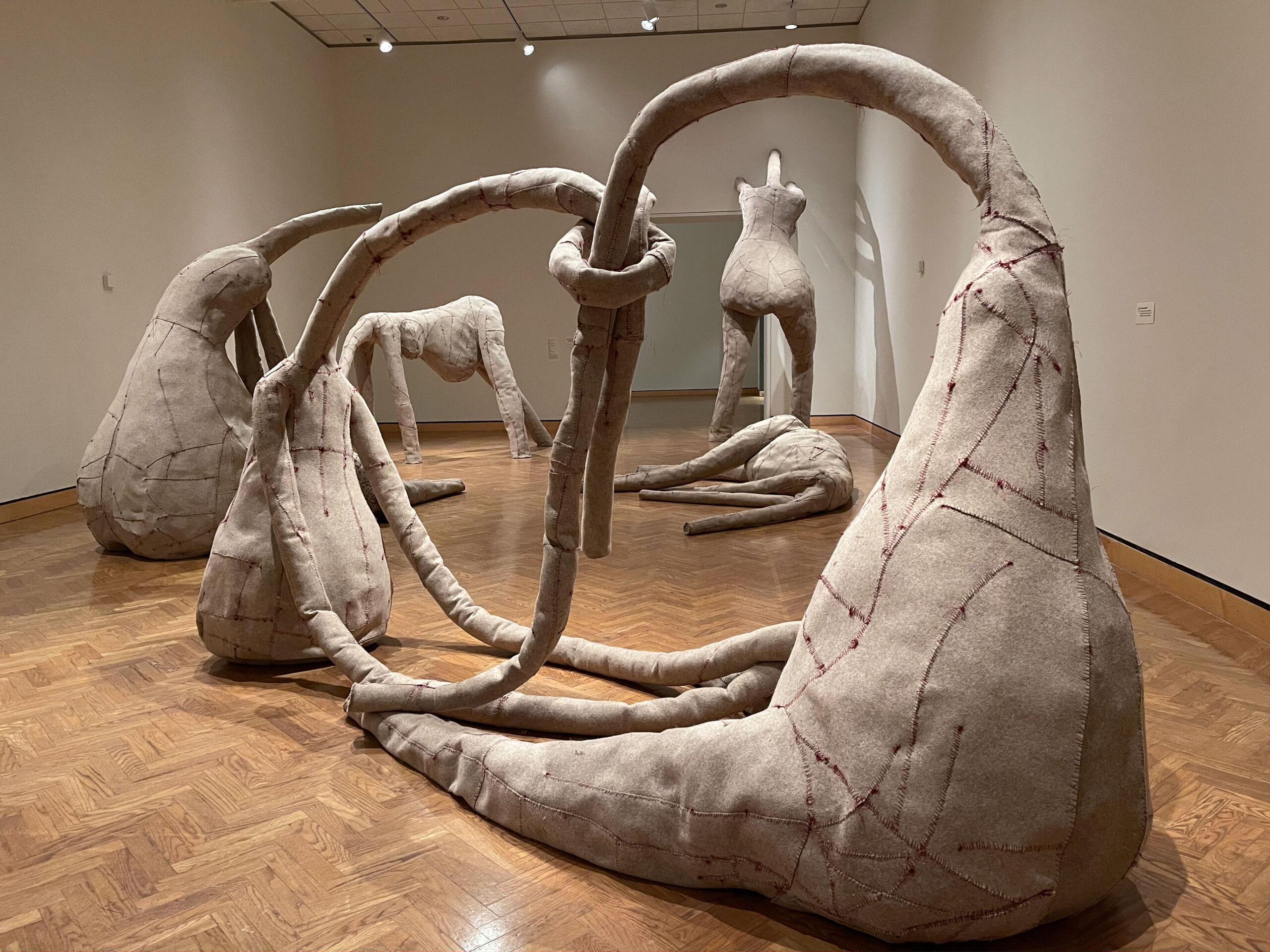 Group of gray felt figurative sculptures