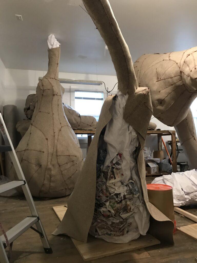 Felt sculptures in crowded studio