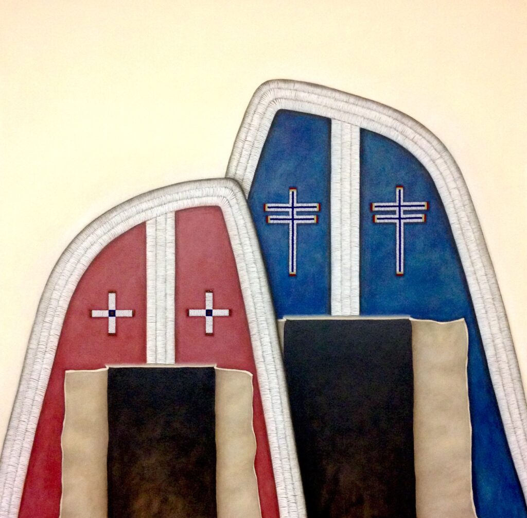 Smaller red and larger blue moccasins with cross patterns.
