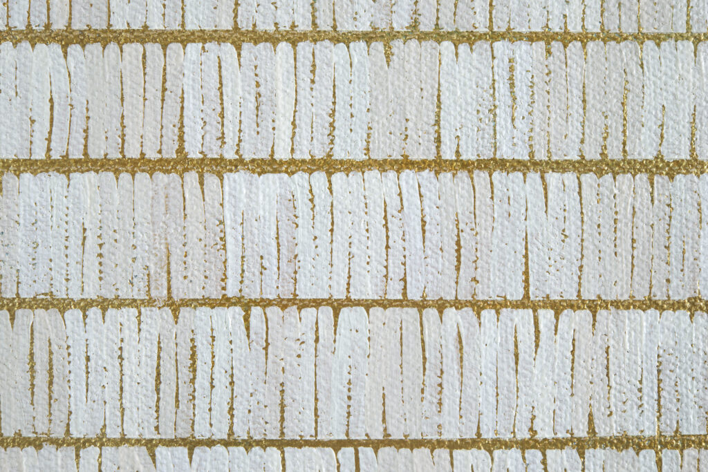 Detail view: square painting with rows of white brush strokes over gold background.