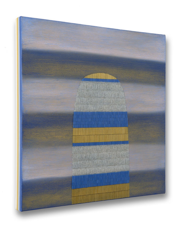 Side view of blue, yellow, and white striped painting with oblong beaded shape.