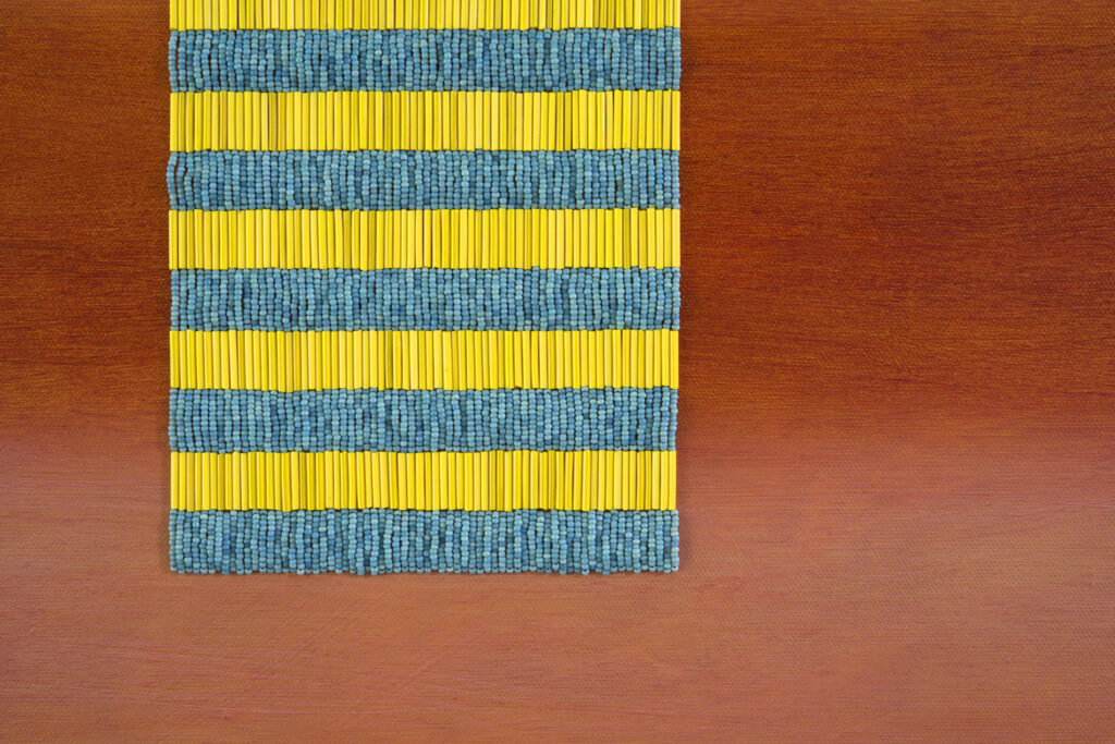 Detail of painting: rectangle with beaded yellow and turquoise stripes, against lighter and darker coral stripes.