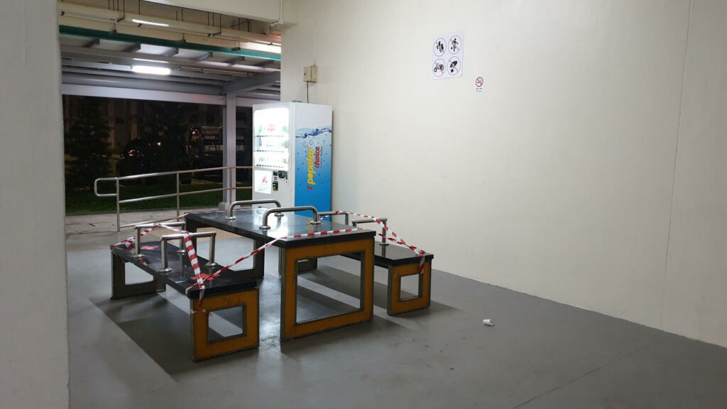 An indoor table is roped off with red and white tape/string