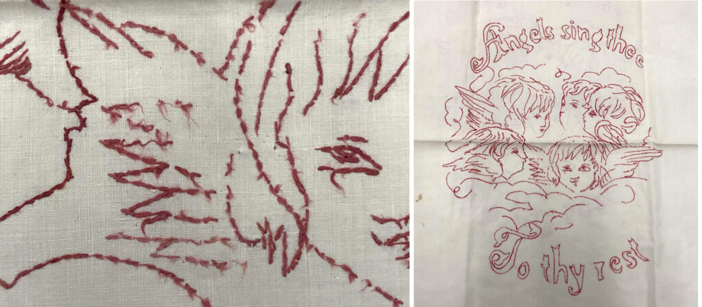 """Detail of red embroidery thread, with face and wing of angel /Off-white vintage textile with four angels embroidered in red thread. Embroidered text reads: """"Angels sing thee / To thy rest."""""""